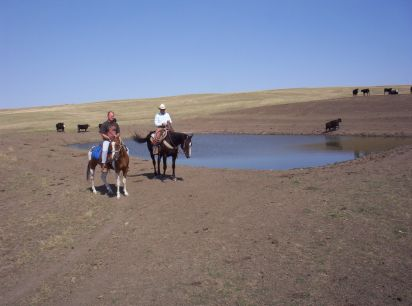 Deron & MC checking a pond